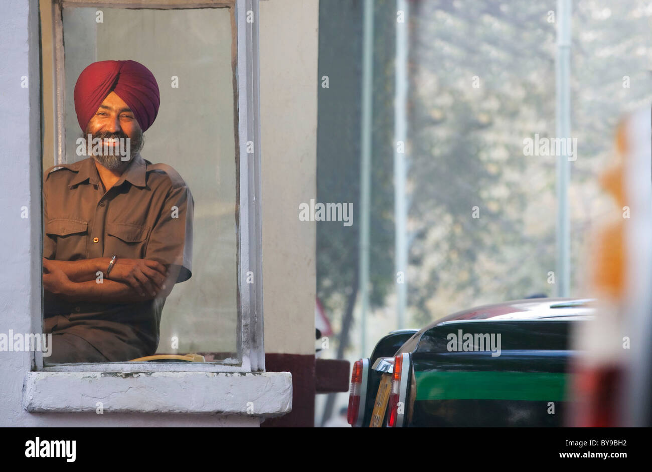 Portrait of a Sikh taxi driver at the taxi service - Stock Image