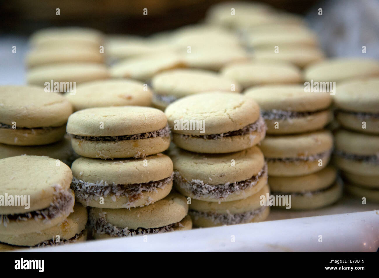 Alfajores, traditional Argentine cookie filled with dulce de leche, as seen in a Buenos Aires bakery. - Stock Image