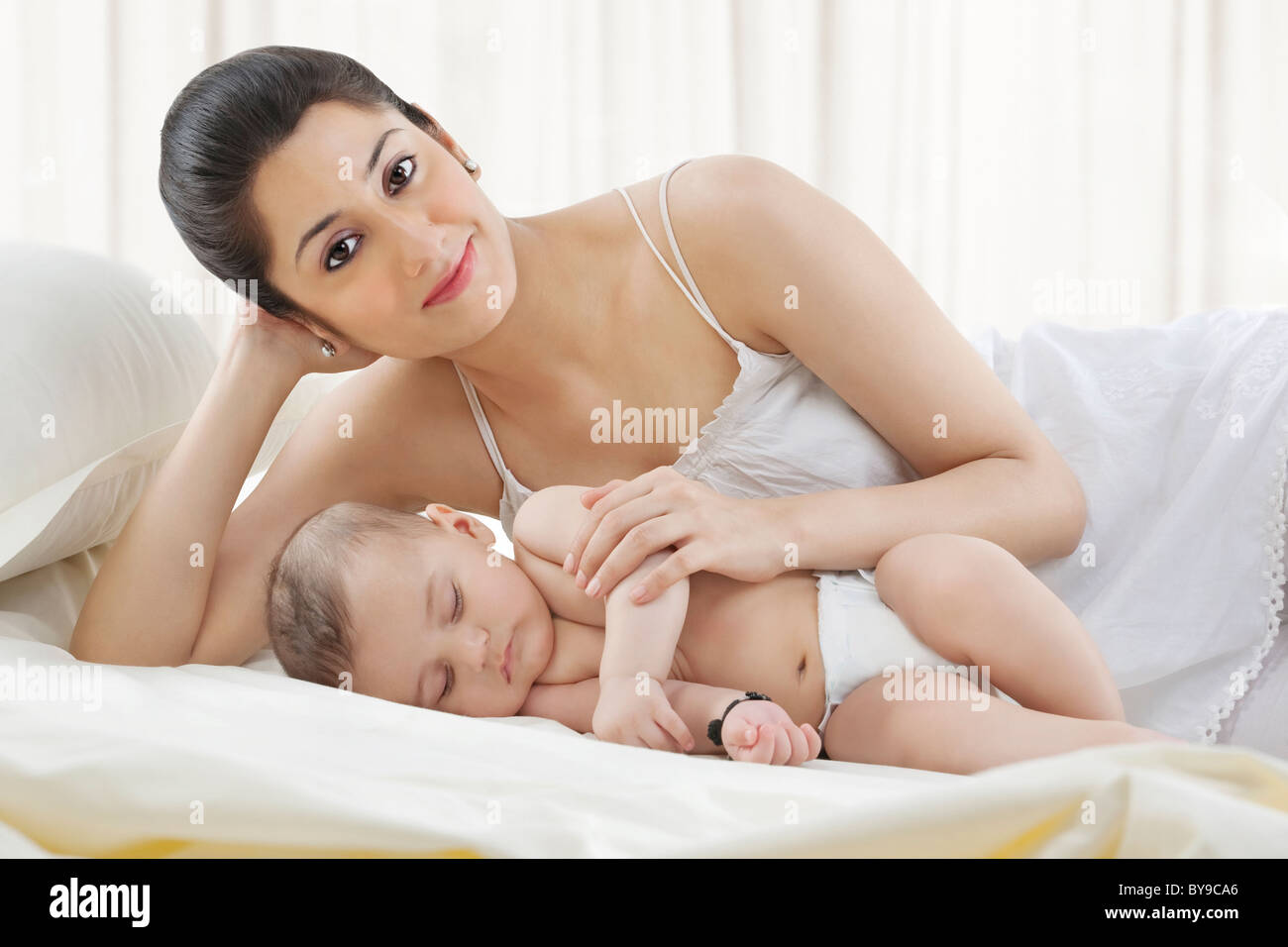 Portrait of a mother with her baby sleeping - Stock Image