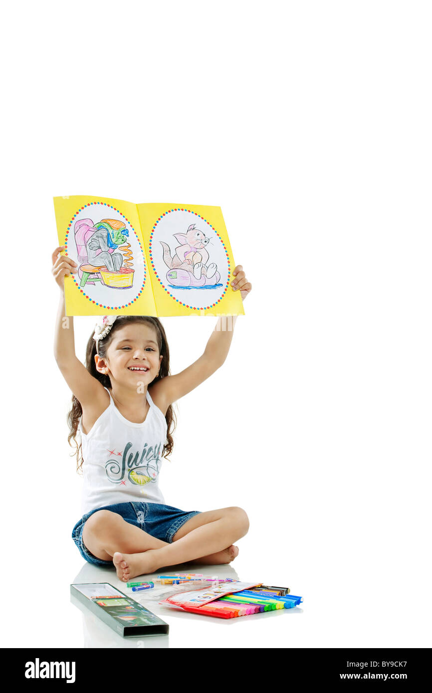 Girl showing her drawings - Stock Image