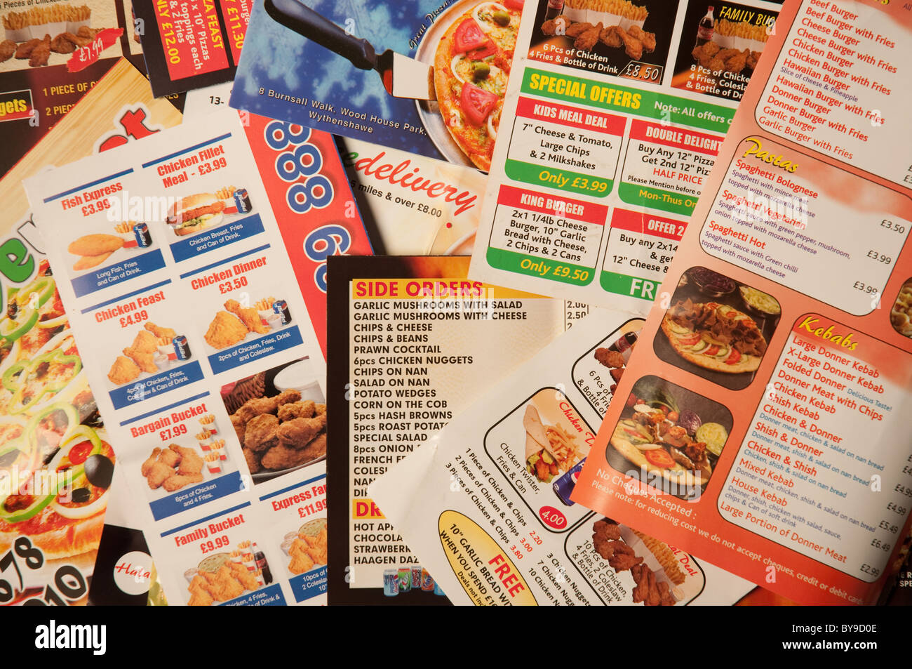 Selection of fast food flyers/mailers typical of the millions that are posted through letterboxes every year. - Stock Image