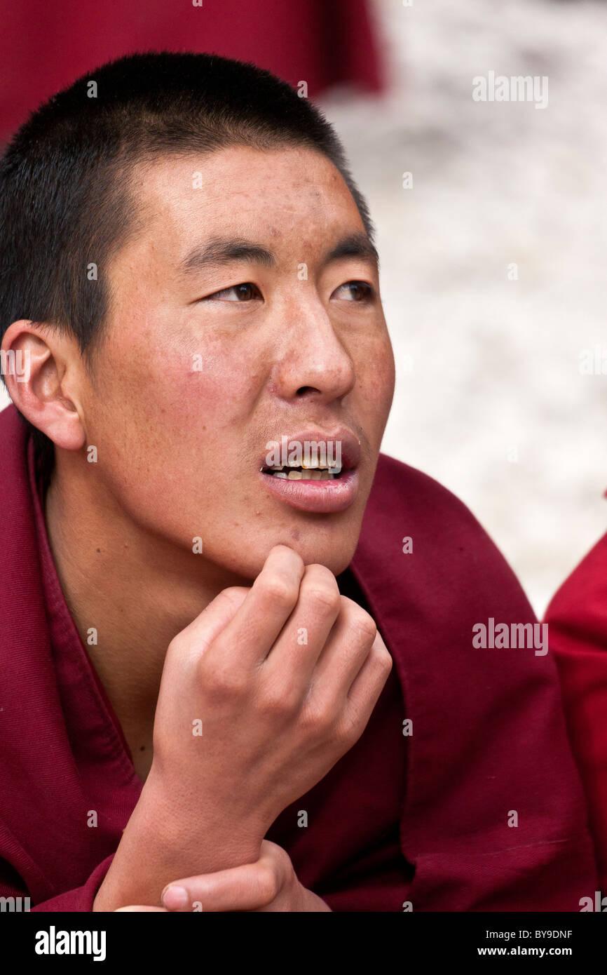 Monk in the Debating Courtyard at Sera Monastery Lhasa Tibet. JMH4610 - Stock Image