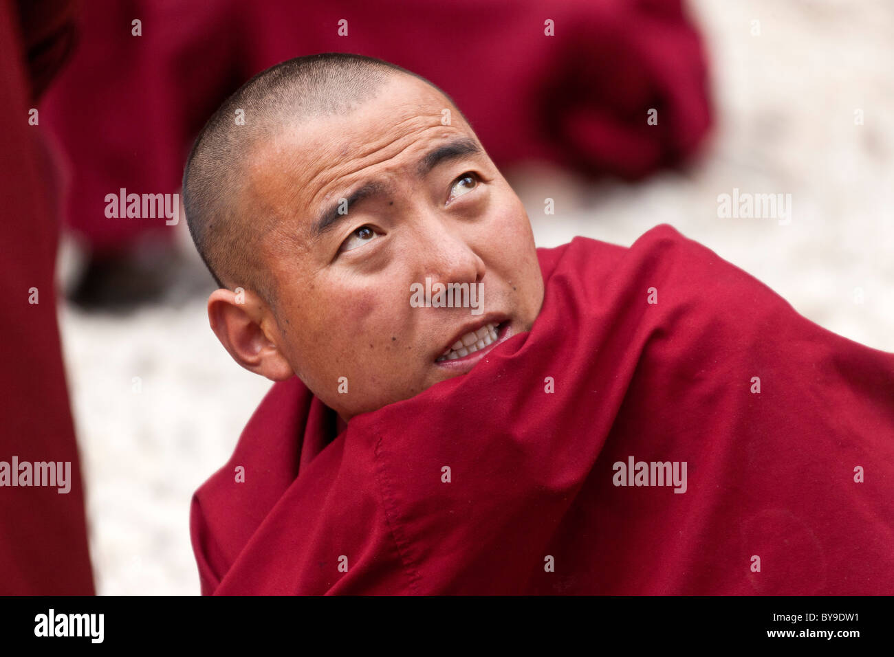 Monk in the Debating Courtyard at Sera Monastery Lhasa Tibet. JMH4611 - Stock Image