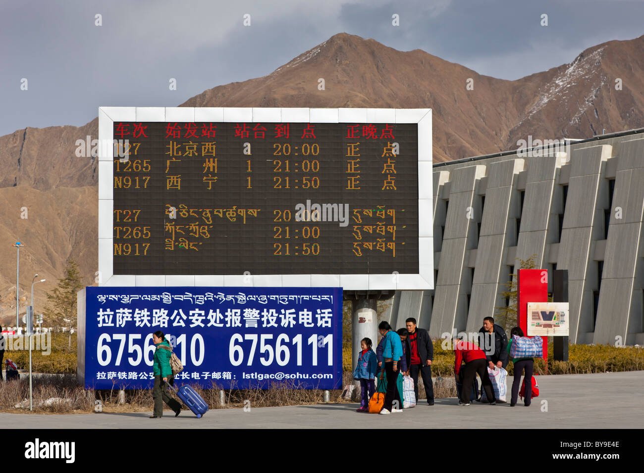 Departures board outside the railway station Lhasa Tibet. JMH4615 - Stock Image