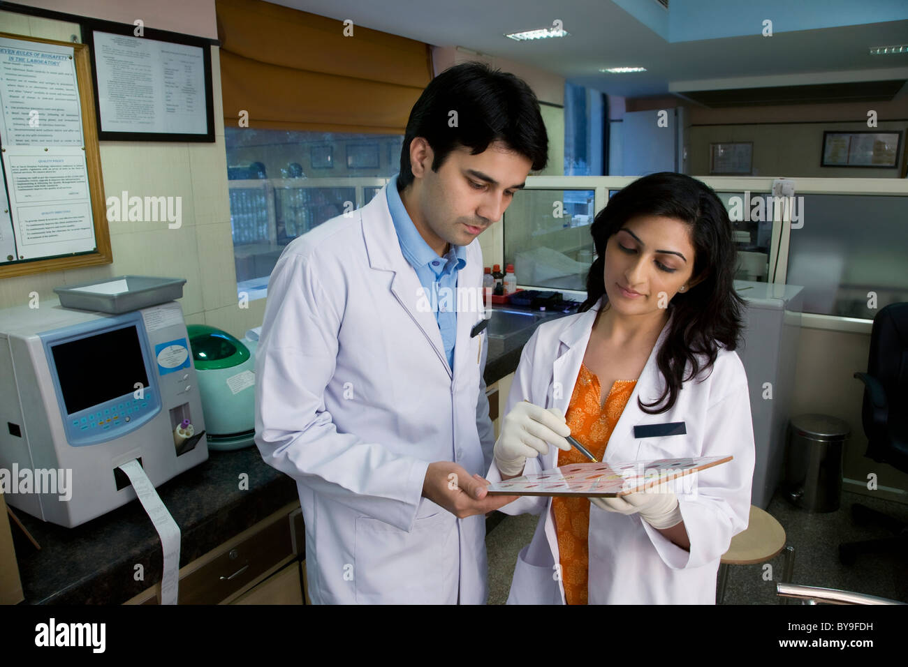 Doctors looking at a report - Stock Image