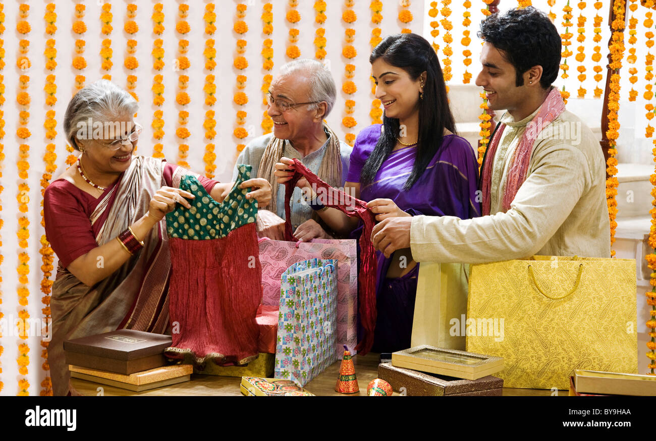 Family looking at diwali gifts Stock Photo: 34017266 - Alamy for Diwali Gifts For Family  55dqh