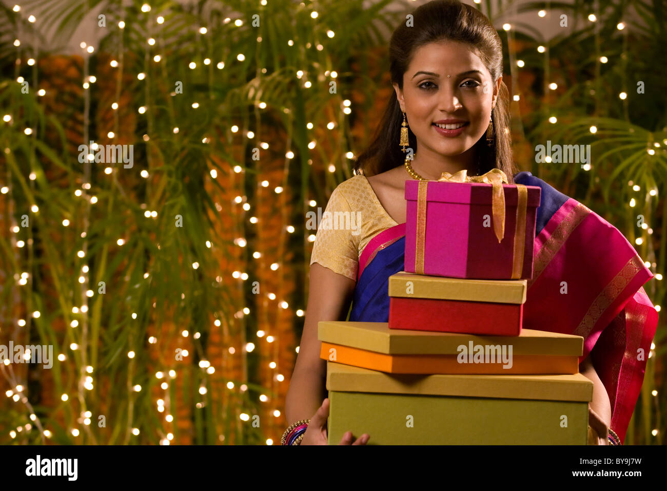 Portrait of a woman with gifts - Stock Image