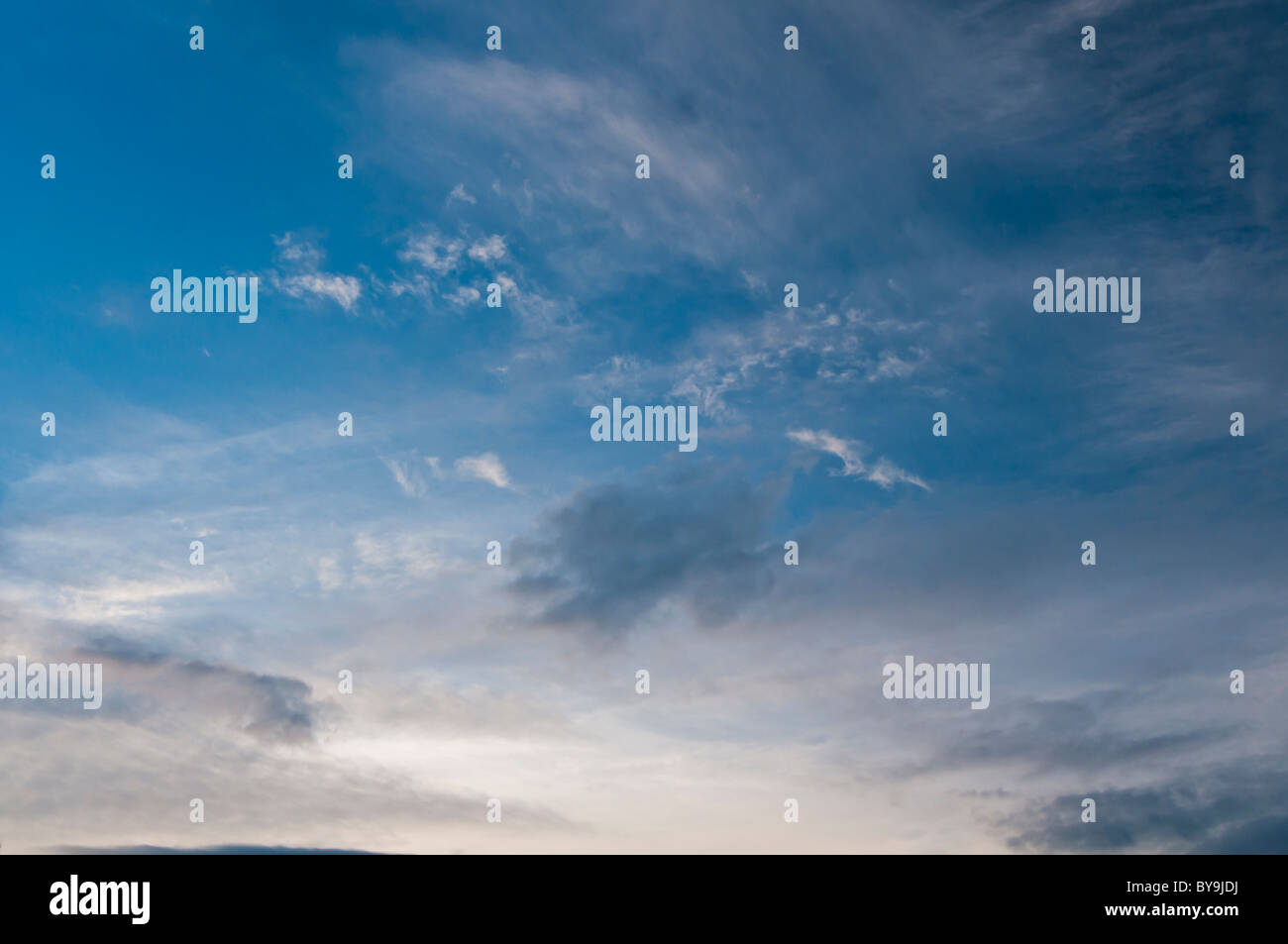 Blue daytime sky with clouds - Stock Image