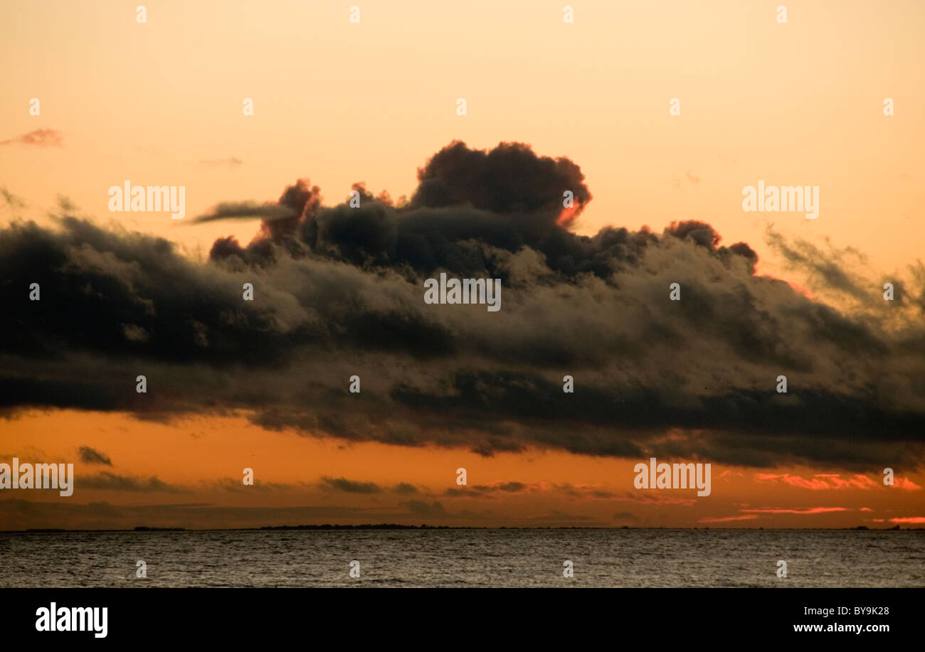 Dark clouds Sunset Seascape West Sussex - Stock Image