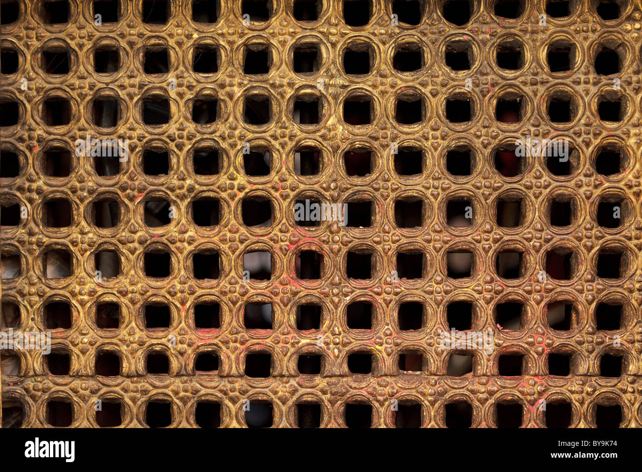 carved wooden temple grid in Nepal - Stock Image