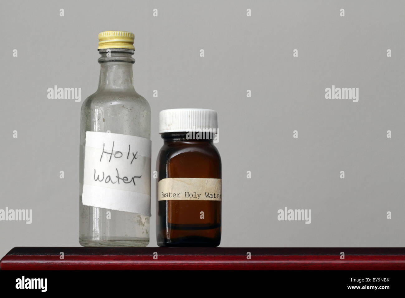 Twon old bottles containing Holy Water - Stock Image