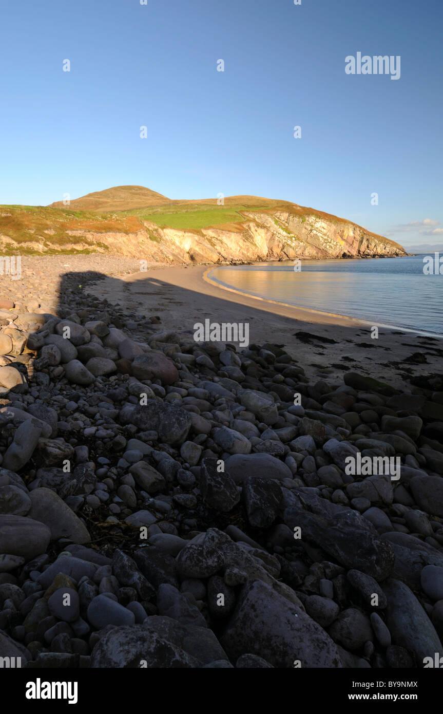 Minard beach boulders rocks shadow of ruined castle soft evening light county kerry ireland - Stock Image