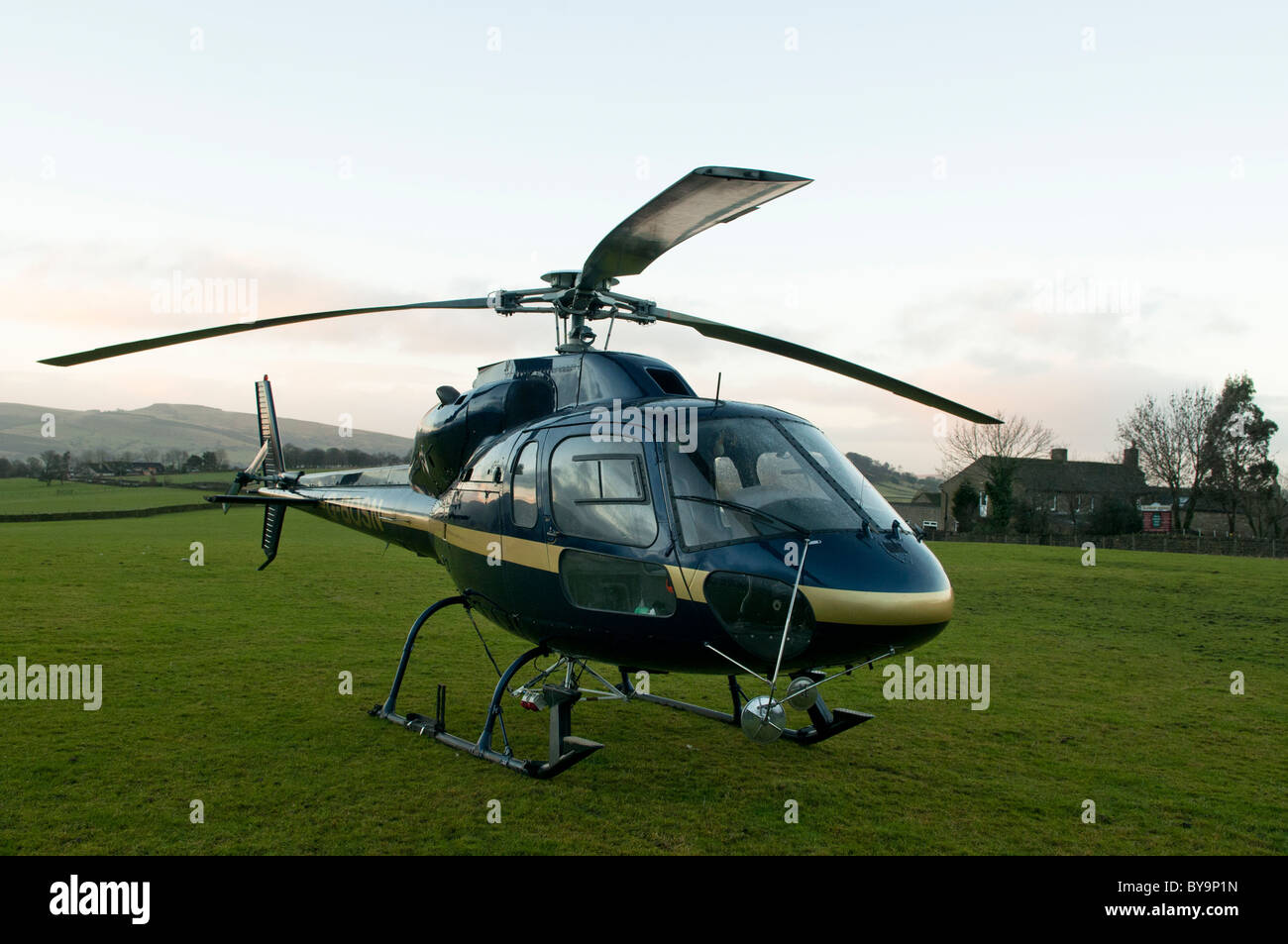Aerospatiale AS 355F 2 Twin Squirrel Helicopter parked in the Penines whilst in a Heli-Lifting role - Stock Image