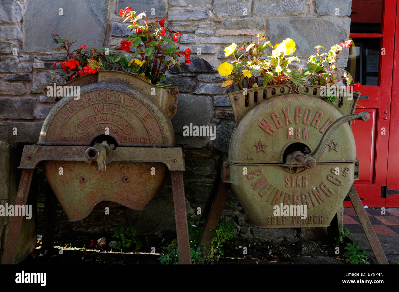 self feeder horticulture agricultural implement vintage reuse reused recycle urban gardening planter flower bed - Stock Image