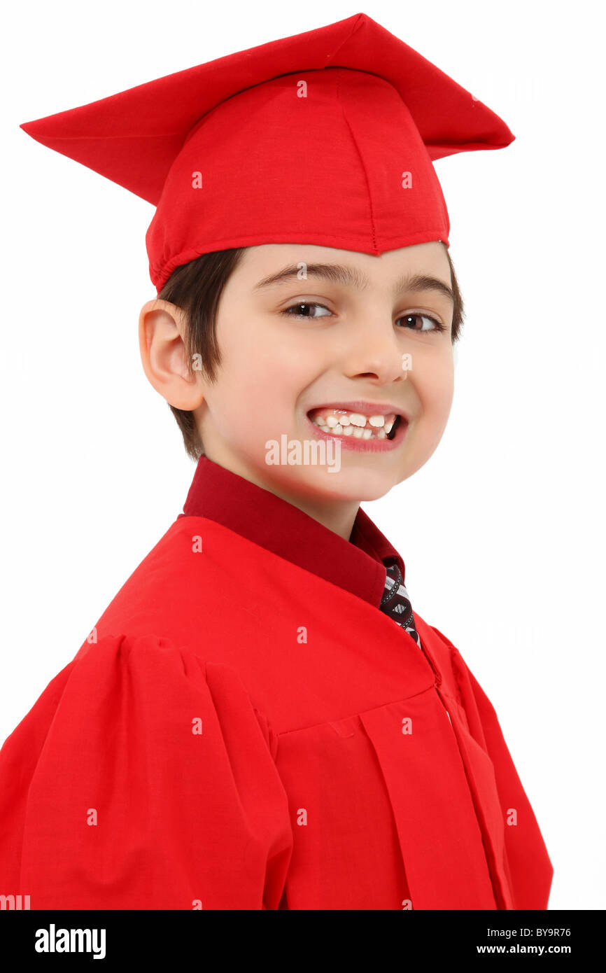 Attractive young kindergarten graduate in red cap and gown over ...