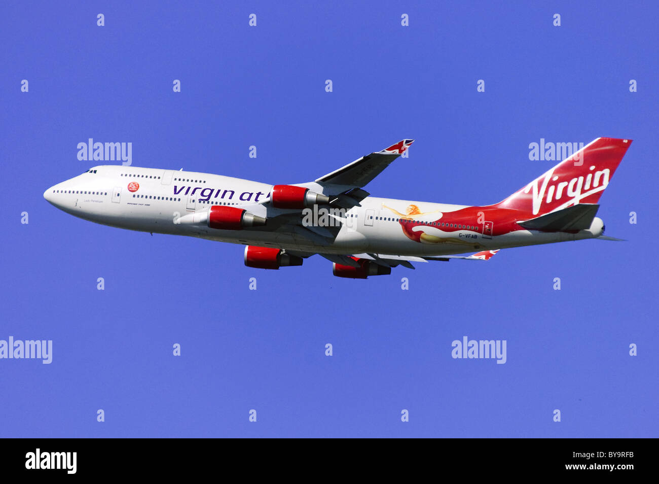 Boeing 747 operated by Virgin Atlantic climbing out after take off from London Heathrow Airport - Stock Image