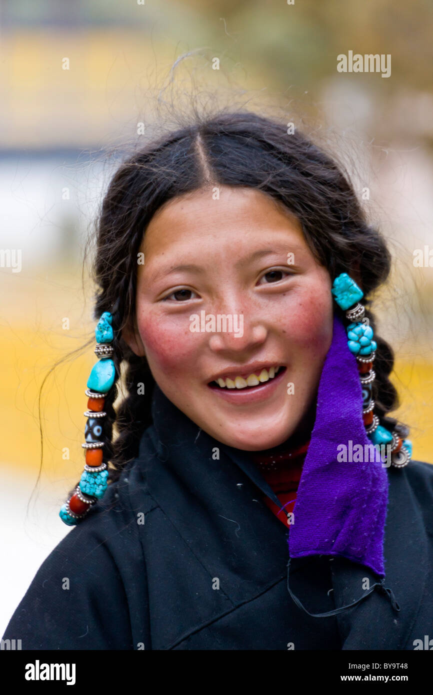 Beautiful Tibetan young woman pilgrim at Norbulingka or Jewel Park, Tagten Migyur Podrang, Lhasa, Tibet, China. Stock Photo