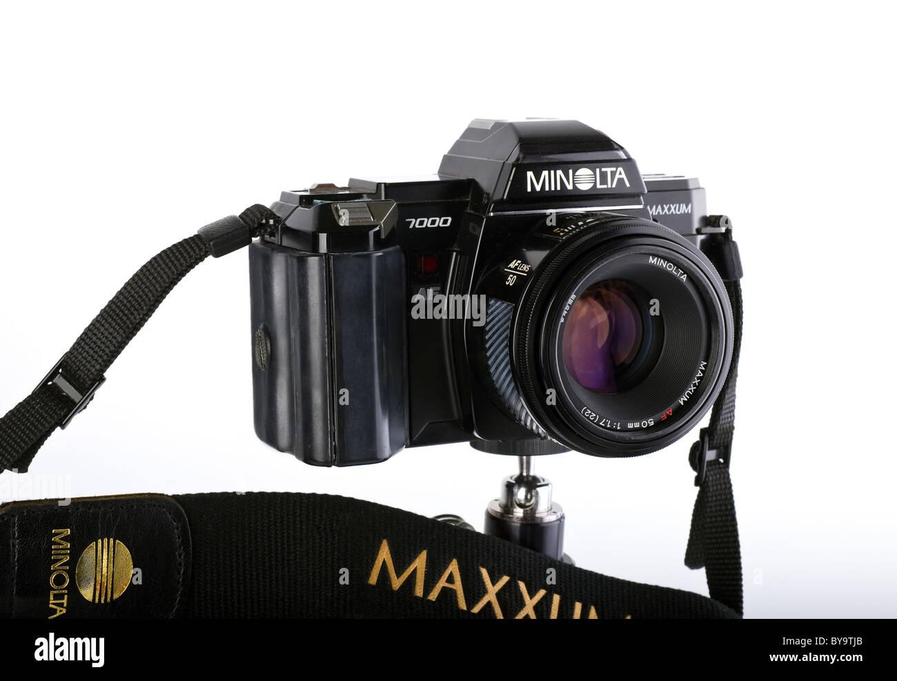 Vintage Minolta Maxxum 7000 35mm film camera strap and lens on white background. Stock Photo