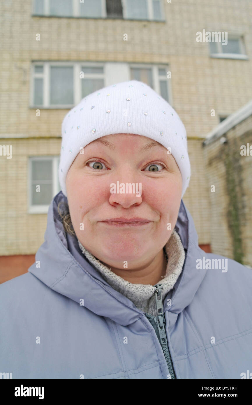 Surprise, delight and desire on a woman's face, winter in the street in Moscow Region, Russia Stock Photo