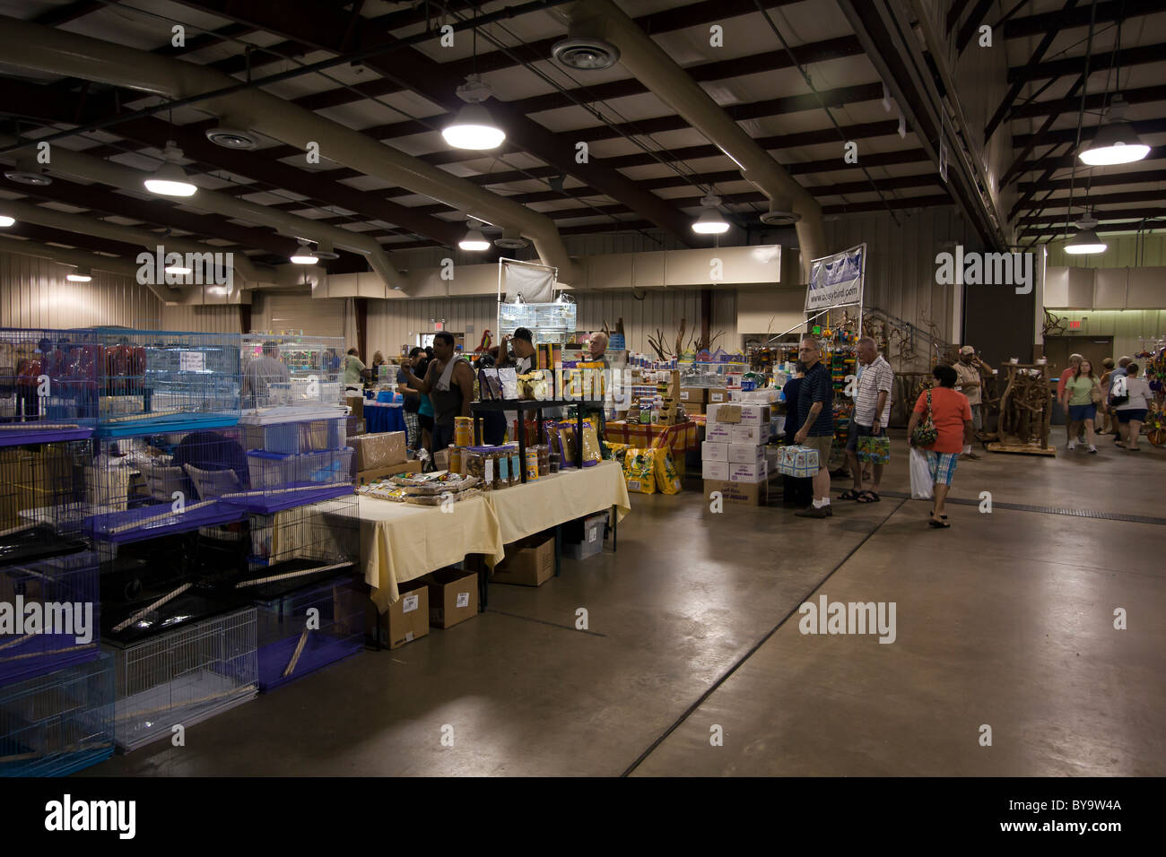 Low turnout at bird expo reflect a poor economy. - Stock Image