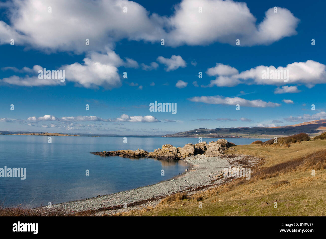Carrick Shore with rocky spit and big blue sky, Galloway and Fleet Bay Stock Photo