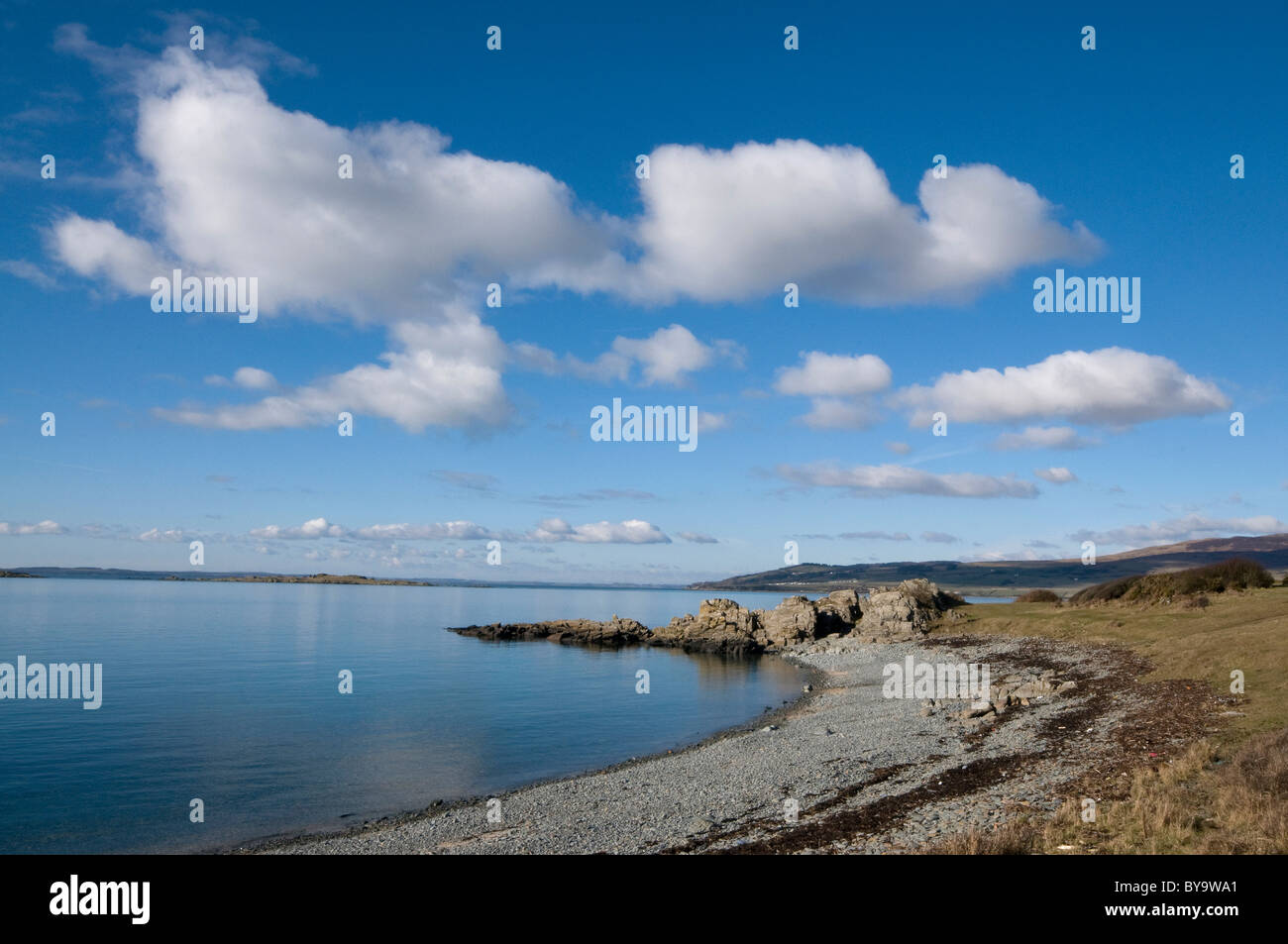 Carrick Shore with rocky spit and big blue sky, Galloway and Fleet Bay - Stock Image