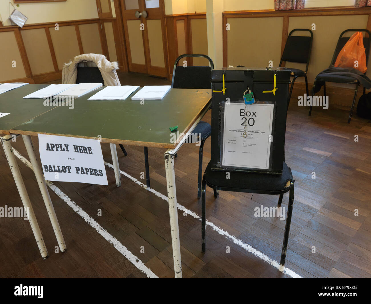 Ballot Box with Official Seals And Table With Ballot Papers General Election May 2010 in Church Hall England - Stock Image