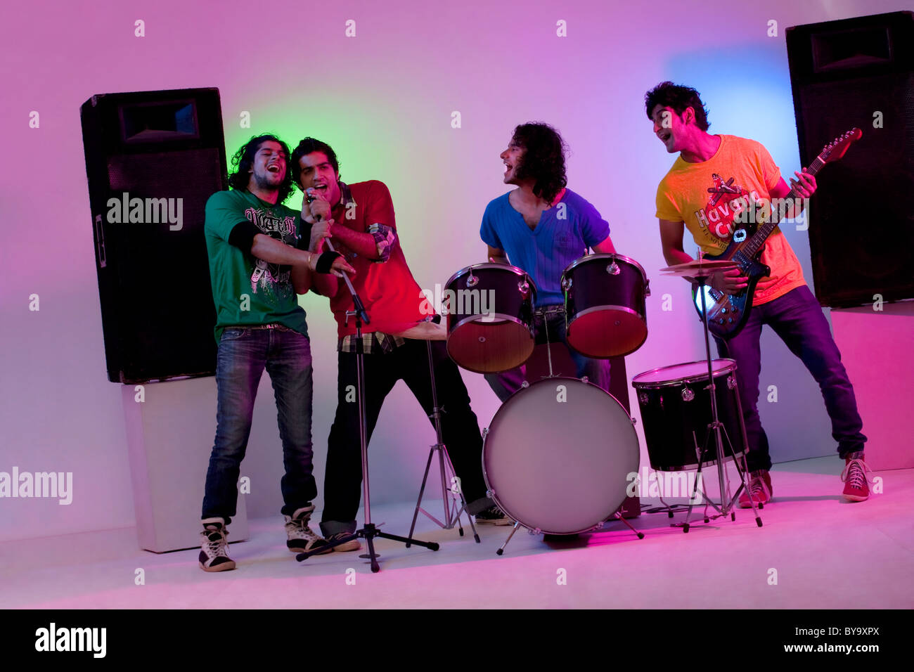 Boys of a rock band enjoying themselves - Stock Image
