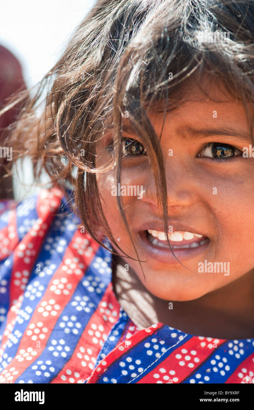 Happy young poor lower caste Indian street girl smiling Stock Photo