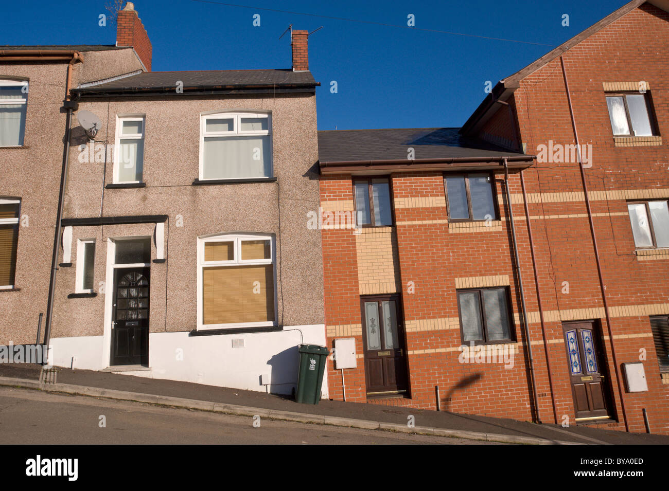 Old and new built terraced houses on hill in Newport South Wales UK Stock Photo