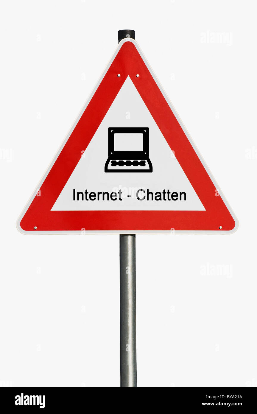 Traffic warning sign with pictogram of a laptop and the term Internet-Chatten, German for Internet chatting - Stock Image