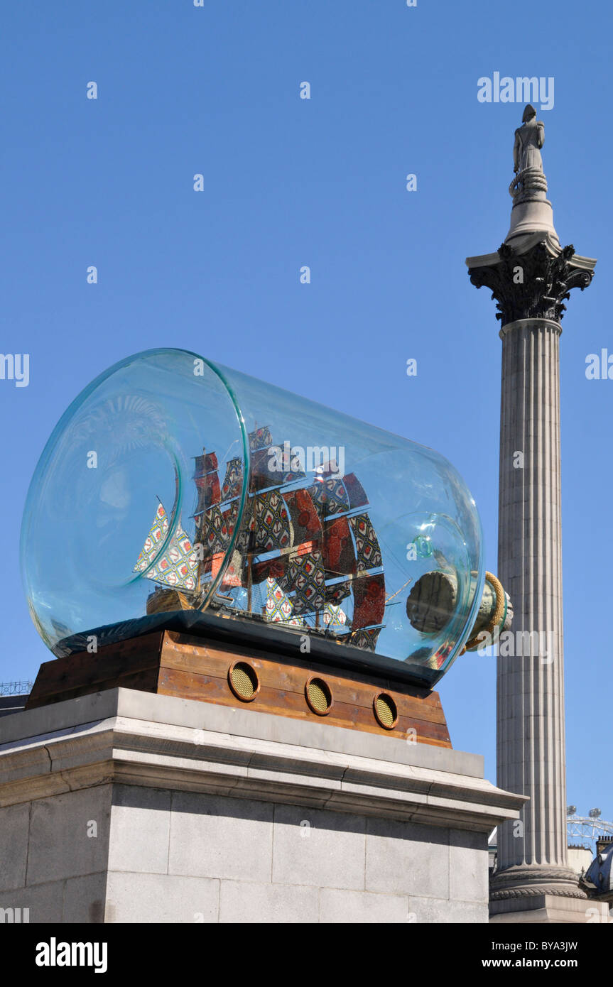 Nelsons flagship Victory in a bottle on the fourth plinth in Trafalgar Square with Nelsons column beyond London - Stock Image
