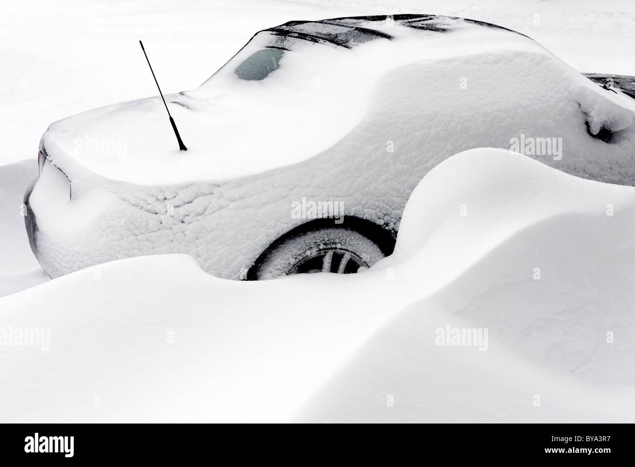 Parked car trapped in a big snowbank, North Rhine-Westphalia, Germany, Europe - Stock Image