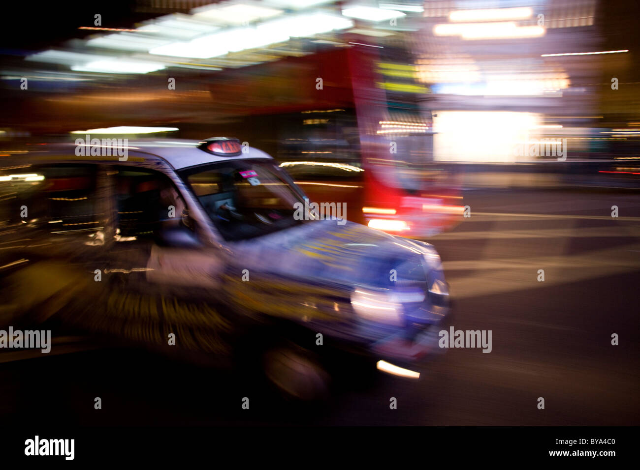 Taxicab in the night, London, England, Great Britain, Europe - Stock Image