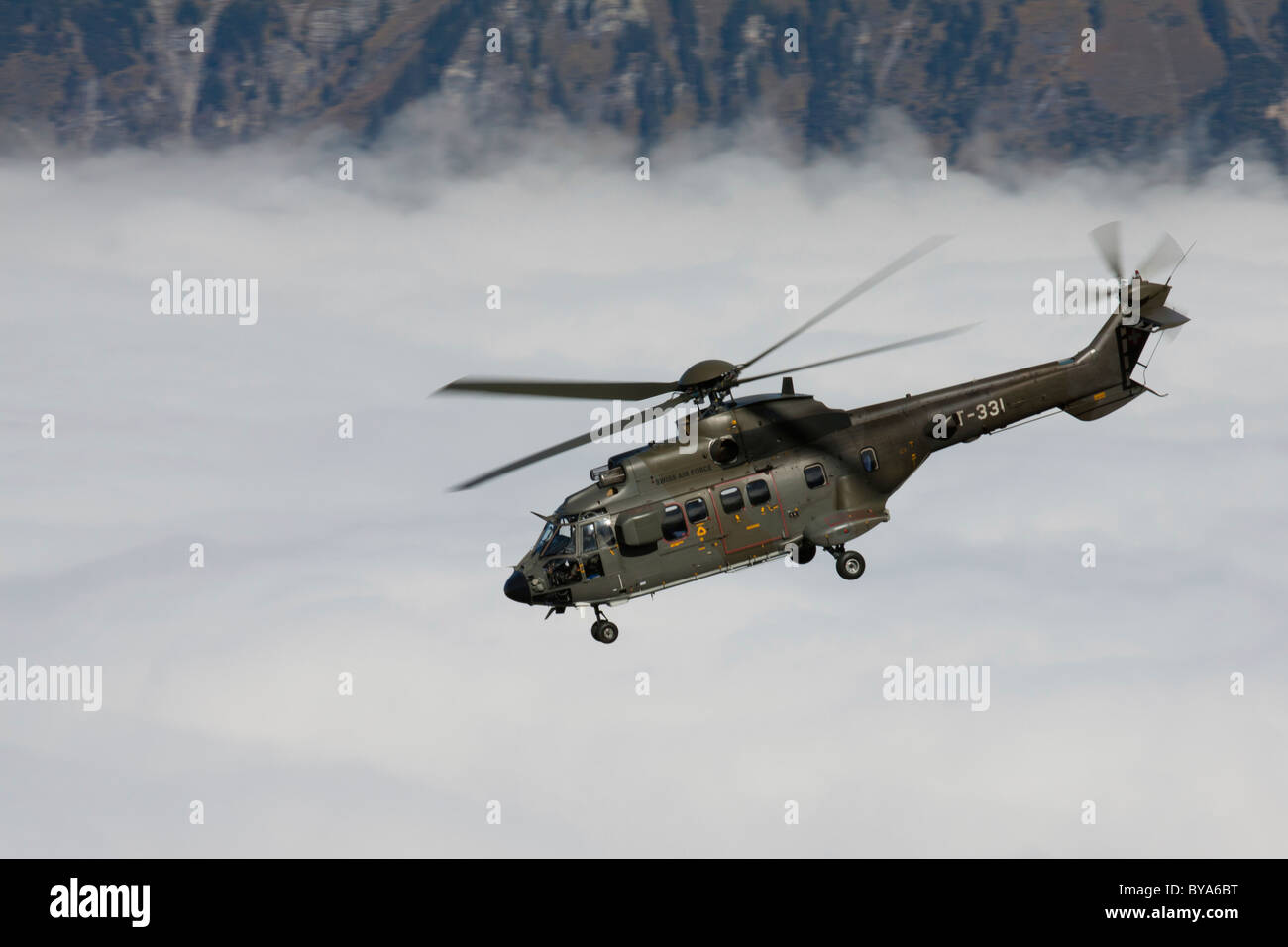 The Swiss military helicopter Cougar above the fog, mountain-air show of the Swiss Air Force at Axalp, Ebenfluh, - Stock Image