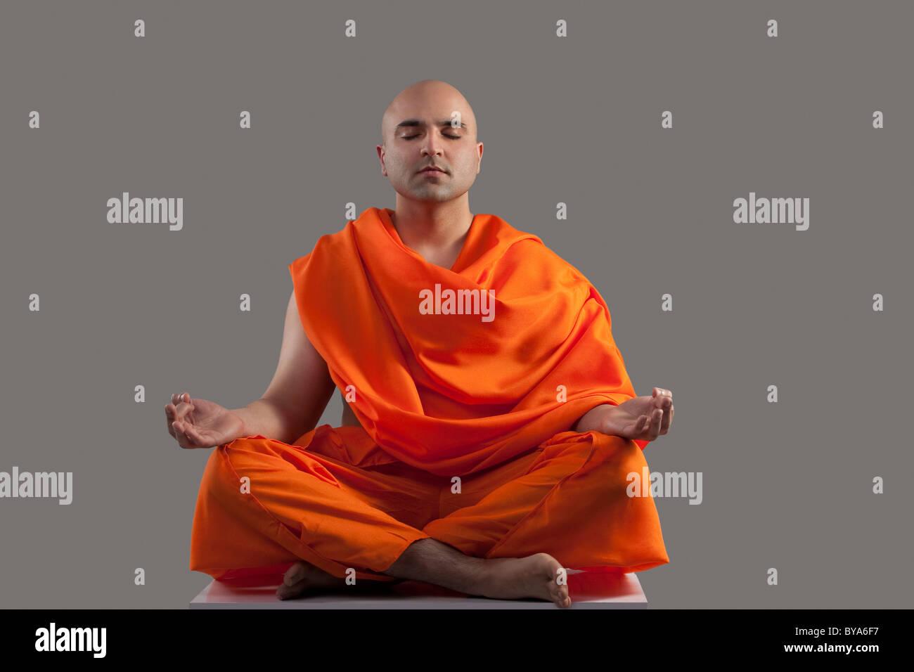 Monk meditating Stock Photo: 34030731 - Alamy Indian Religious Background