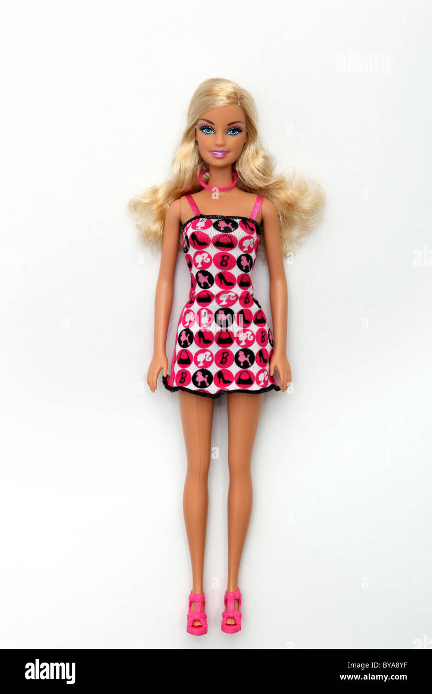 Blonde Barbie doll with both arms by her side. - Stock Image