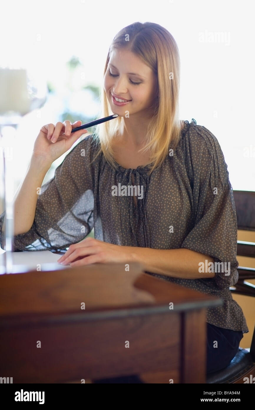 Girl writing a letter - Stock Image