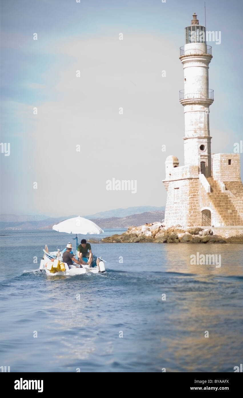 Fisher boat and light house - Stock Image
