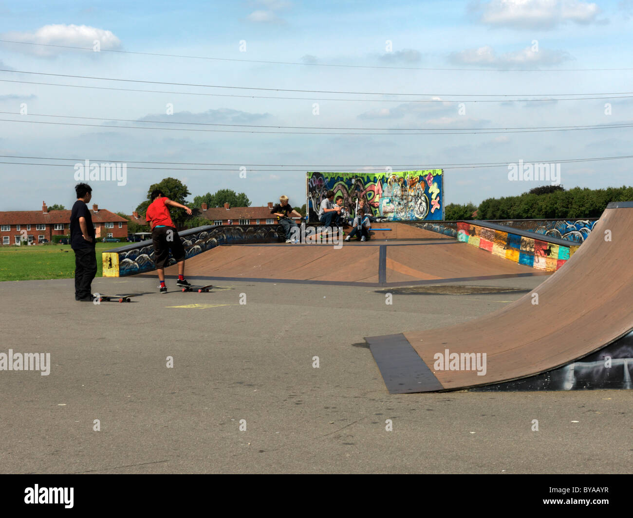 Rosehill Carshalton Surrey England Boys At Skateboard Park Graffiti On Skateboard Ramp - Stock Image