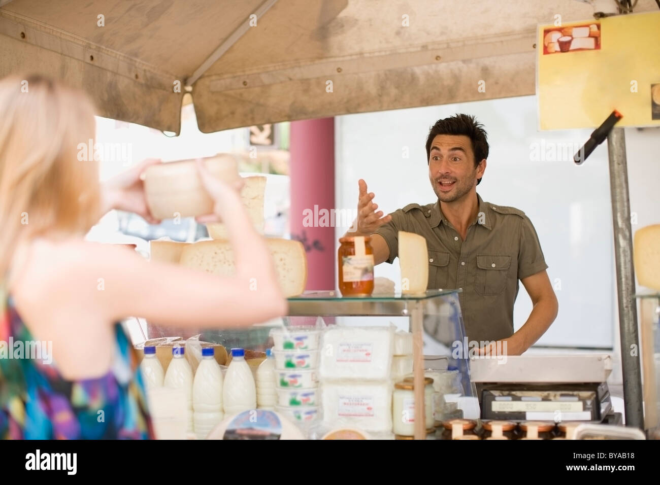 Man working at market - Stock Image