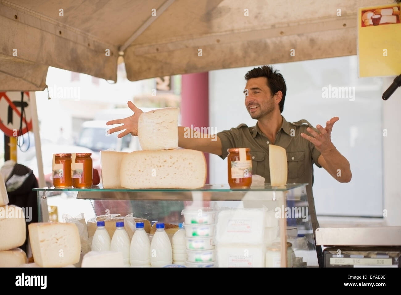 Man selling dairy products - Stock Image