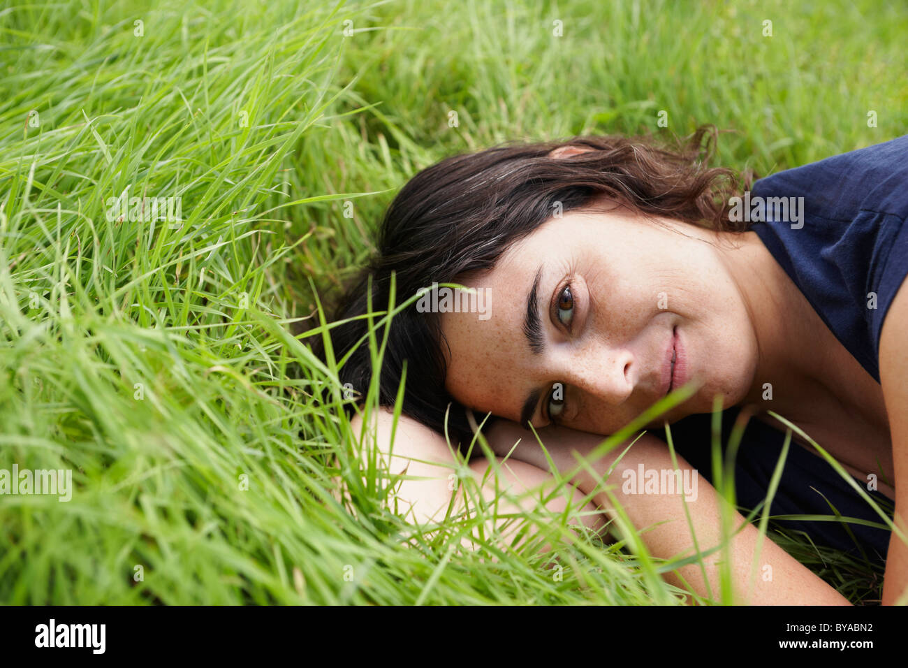 Woman resting in meadow - Stock Image