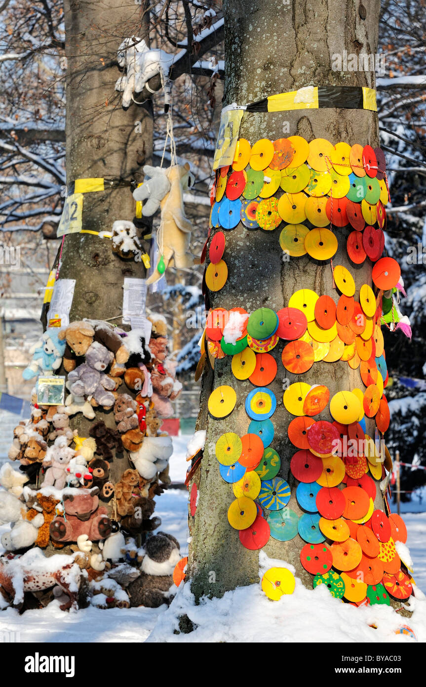 Protest against Stuttgart 21, a controversial urban development and transport project, CDs and cuddly toys on an - Stock Image