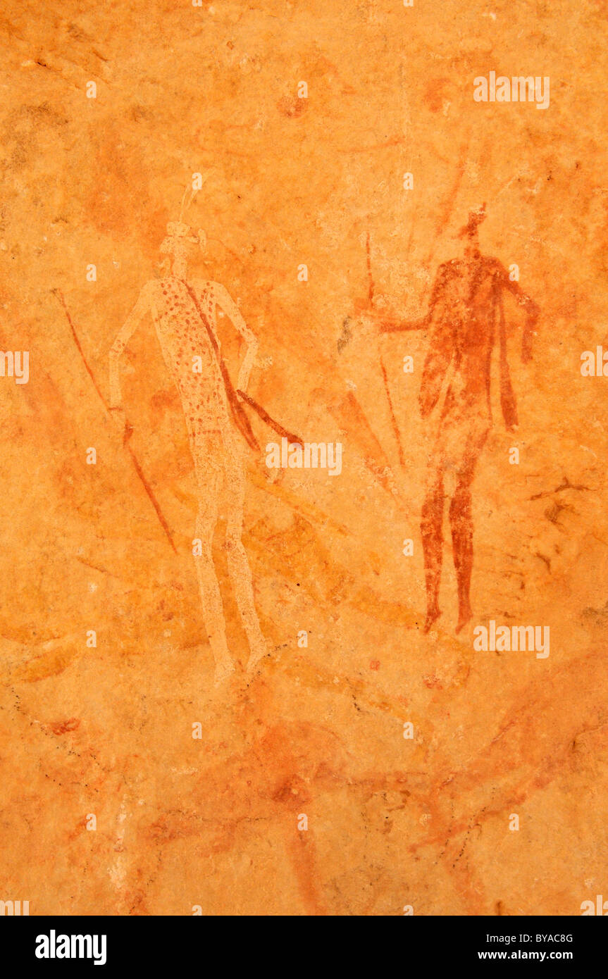 Neolithic rock art, painting of warriors, hunters with bow and arrow, Tasset Plateau, Tassili n'Ajjer National Park Stock Photo