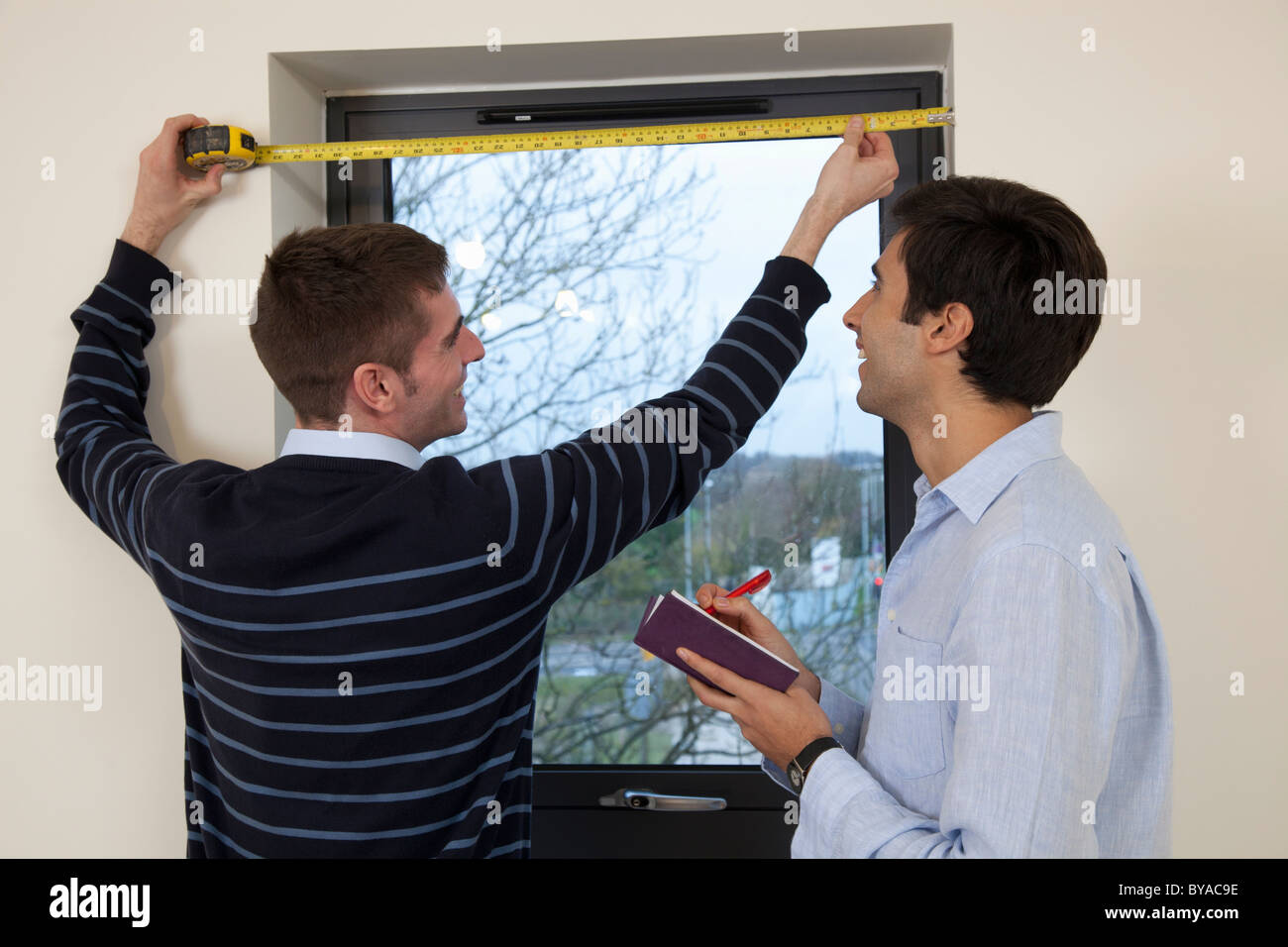 Two developers in their new apartment - Stock Image