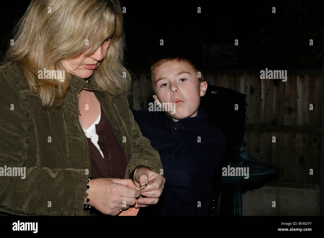 woman examining ring with boy Stock Photo