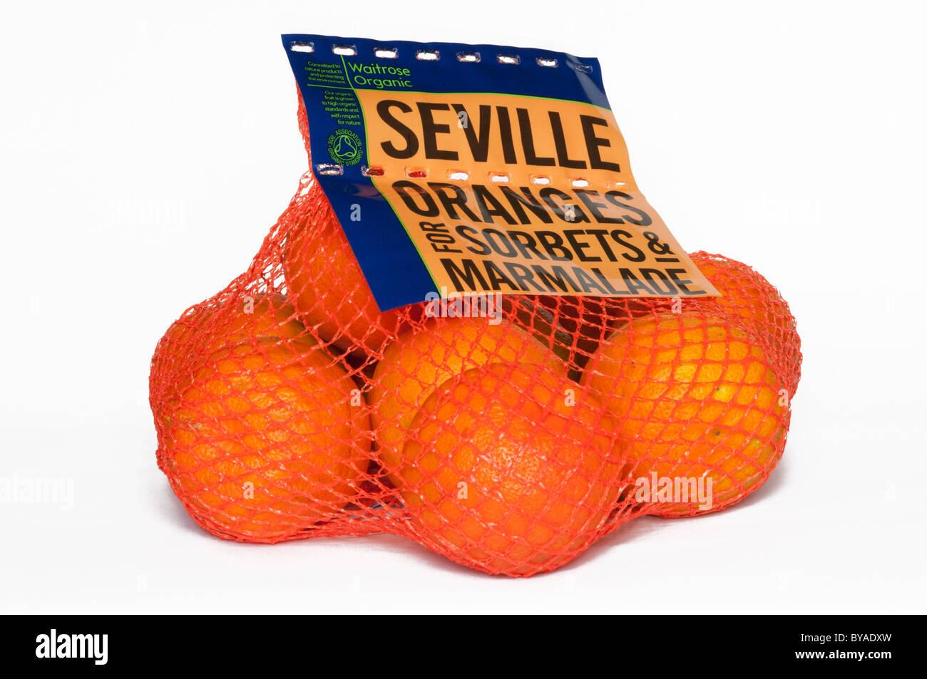 A bag of Seville oranges for making Marmalade. - Stock Image