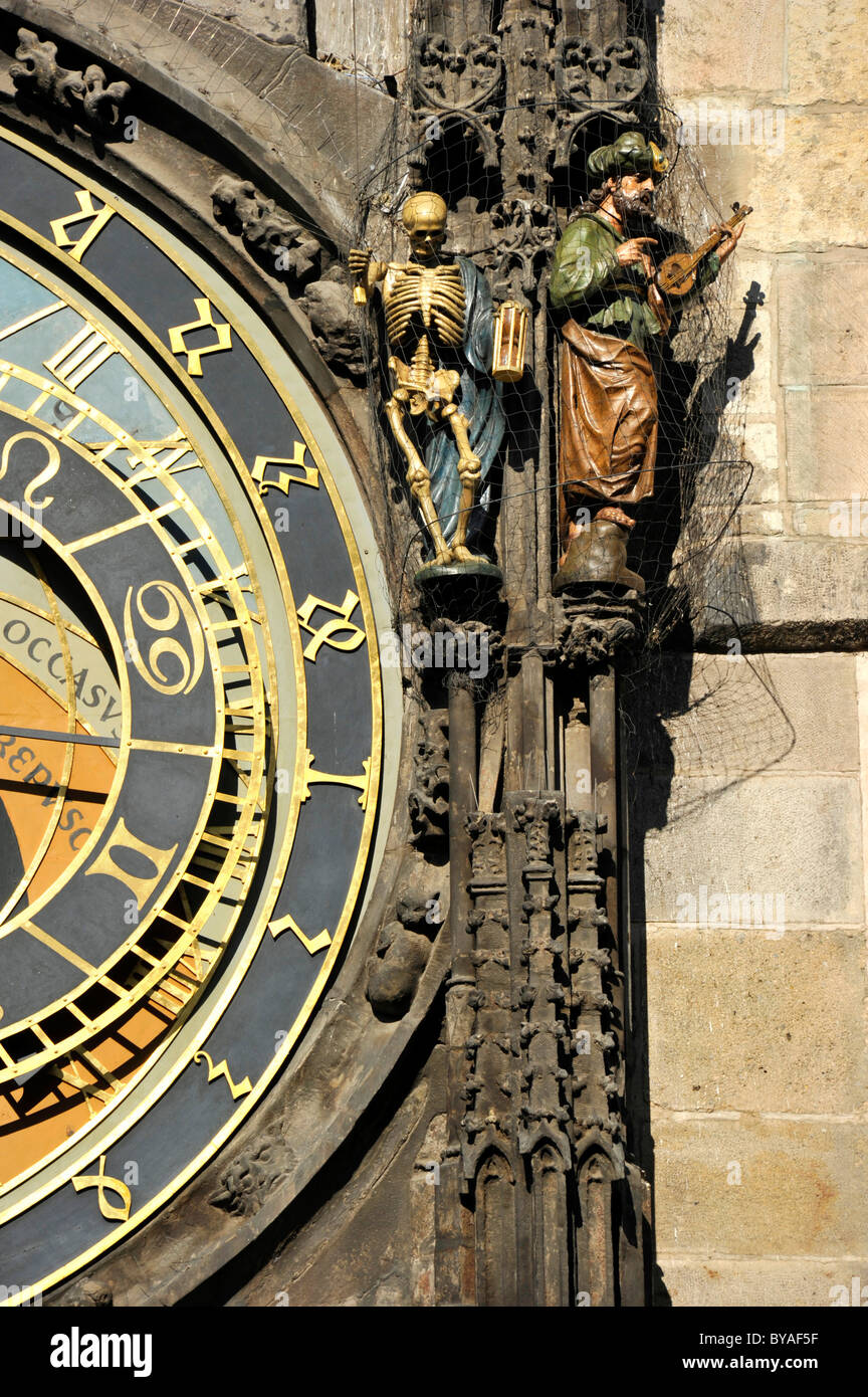 Allegorical statues representing death and paganism on the Prague Astronomical Clock on the clock tower of the Old - Stock Image