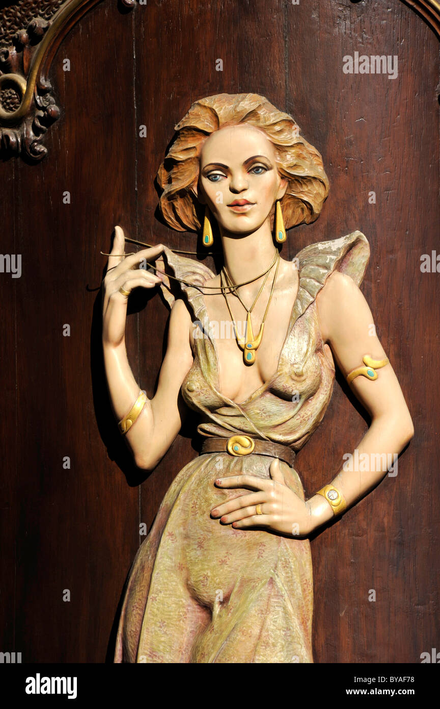 Art Nouveau house emblem of a lascivious woman, wood relief on the facade of the Caffè per Lei Cafe, historic - Stock Image